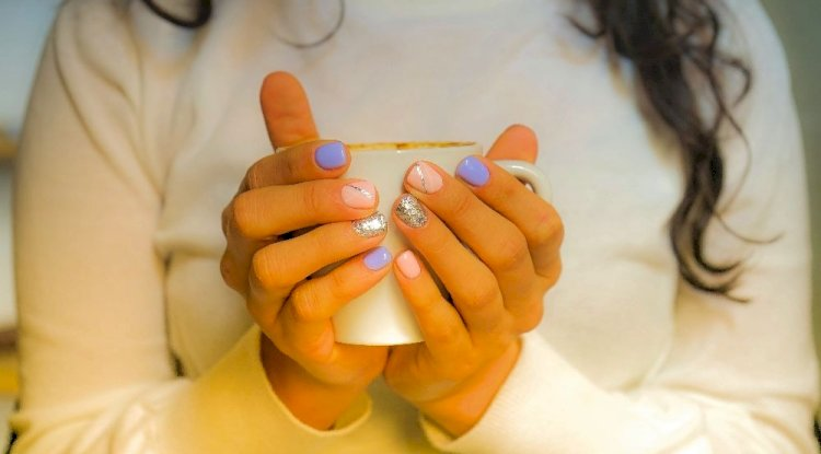 woman-in-white-long-sleeved-top-holding-white-cup