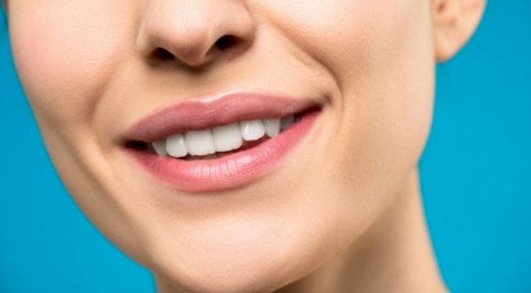 close-up-photo-of-woman-with-pink-lipstick-smiling.jpg
